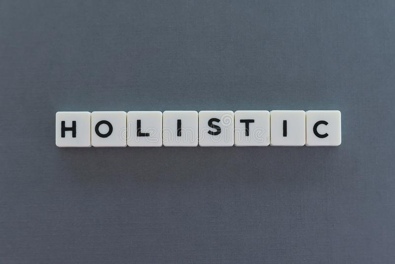 Holistic word made of square letter word on grey background stock photos
