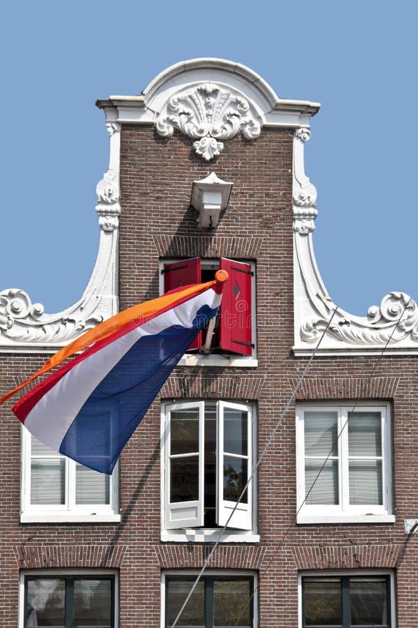 holländsk facadeflaggaholland national royaltyfria foton