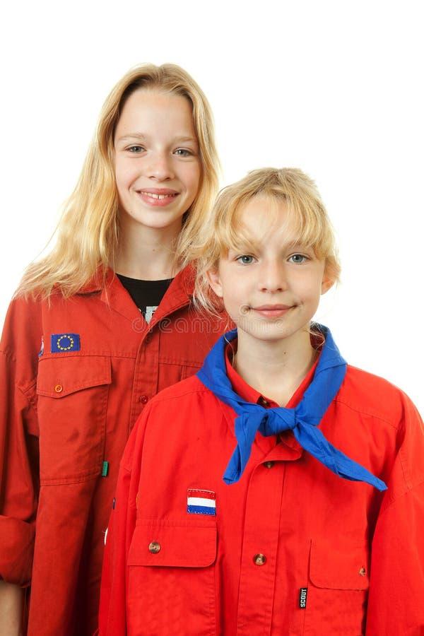 holländska flickor spanar två arkivfoton