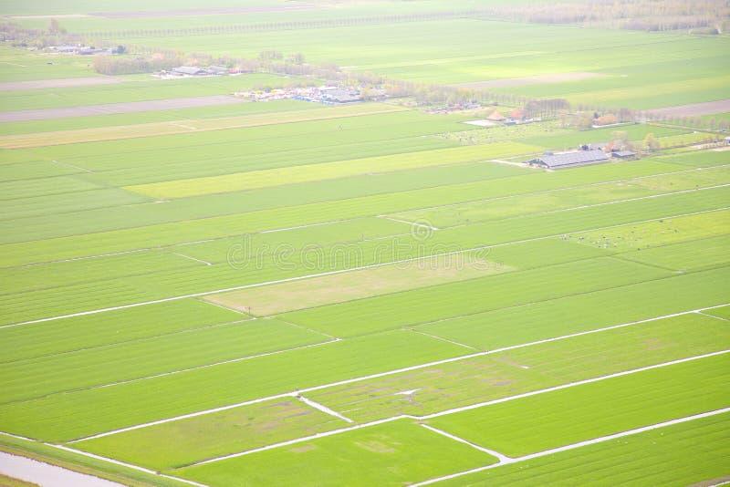 Holländskt lantgårdlandskap från över arkivbilder