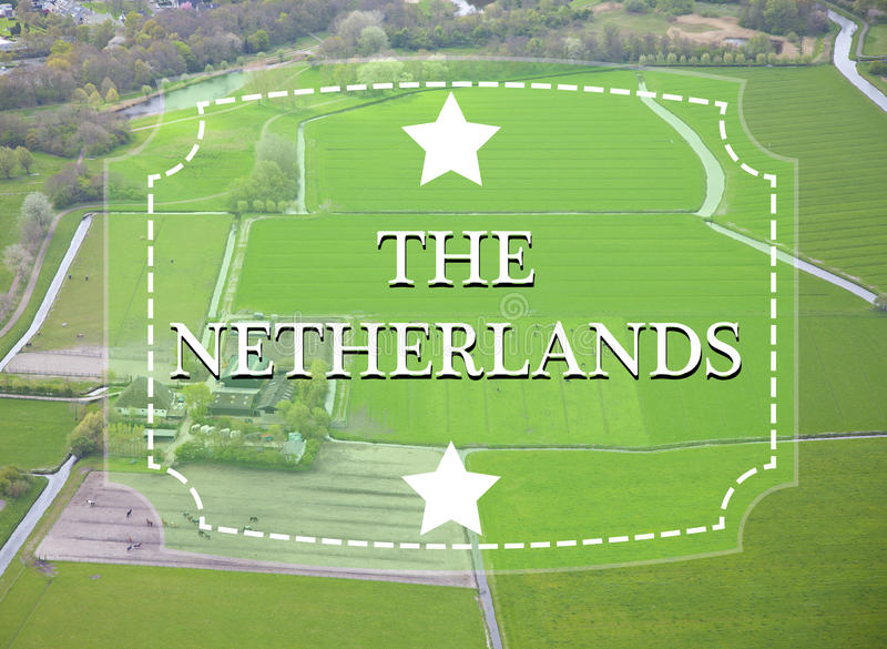 Holländskt lantgårdlandskap med tappningetiketten royaltyfri foto