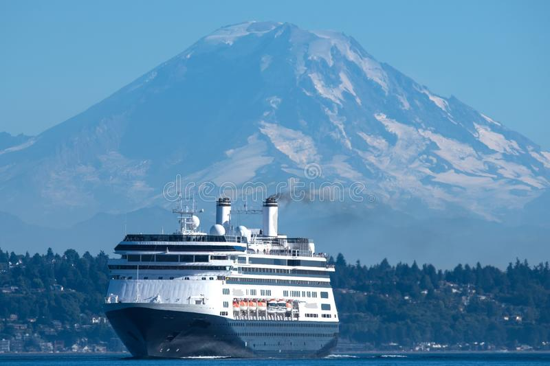 M/V Amsterdam transiting Shilshole Bay. Holland America Line`s M/V Amsterdam leaving Seattle on her way to Alaska with Mount Rainier in the background stock photography