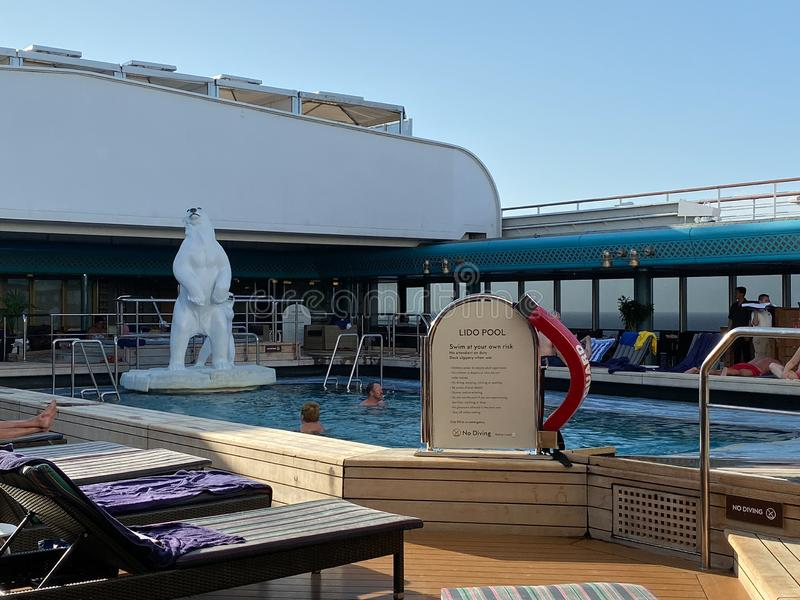 The Holland American Cruise Line Zuiderdam cruise ship indoor pool and hot tub with ornamental polar bears stock photography