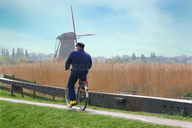 Holland Farmer Riding Bicycle stock photography