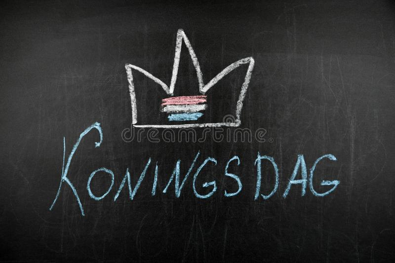 Holland traditional festival Koningsdag Kings day on chalkboard.  stock images