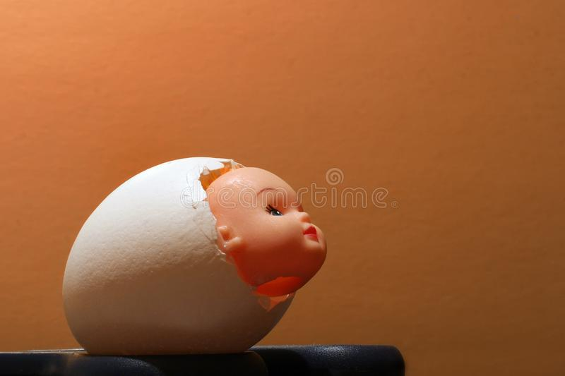 Hollow shell from the egg with the head of the doll inside stock image