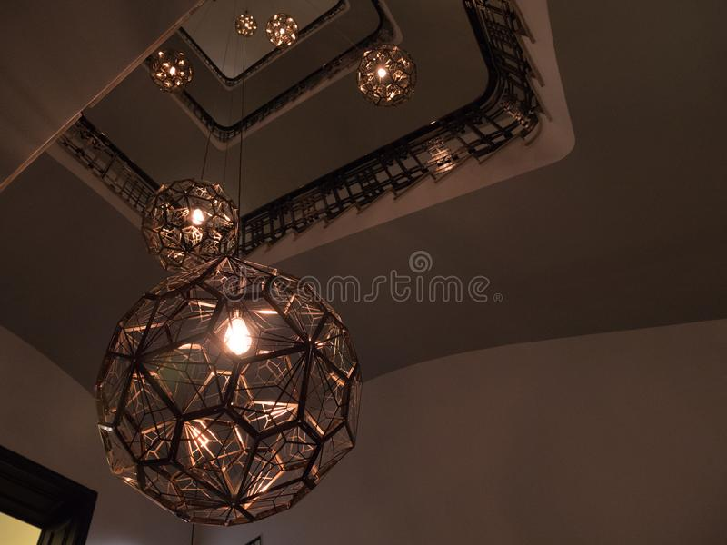 Hollow staircase of luxury hotel with designer lamps with round shape stock photo