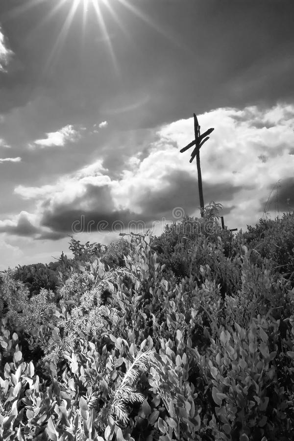 Holly light and cross. In sky royalty free stock photos