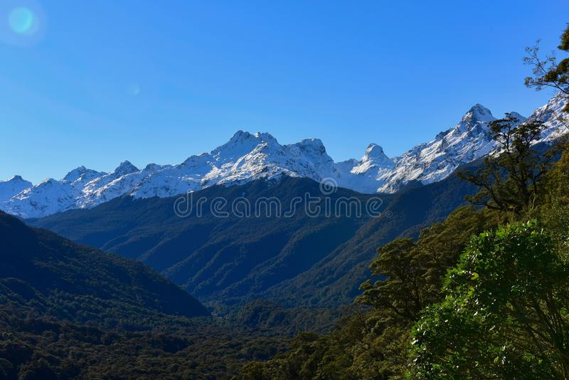Hollyford Valley lookout offering a scenic view of snow mountains in New Zealand royalty free stock photos