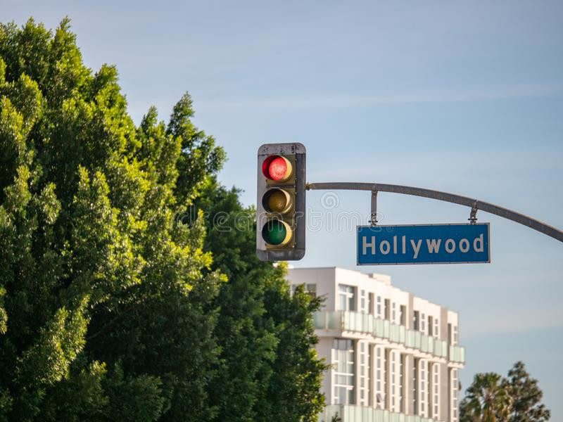 Hollywood Blvd street sign on traffic light at intersection at Los Angeles stock images