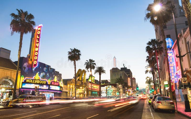 Hollywood Boulevard and Walk of Fame at sunset. LOS ANGELES - MARCH 20, 2015: Hollywood Boulevard at sunset twilight with blurred light tracks - The Walk of Fame stock photo