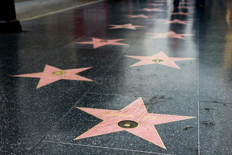 Donald Trump star on the Hollywood Walk of Fame. HOLLYWOOD, CA - DECEMBER 06: Donald Trump`s star has been replaced after vandalizing on the Hollywood Walk of stock images