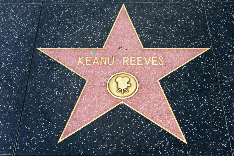 George Lopez star on the Hollywood Walk of FameKeanu Reeves. HOLLYWOOD, CA - February 06: Keanu Reeves star on Hollywood Walk of Fame in Hollywood, California on royalty free stock photography