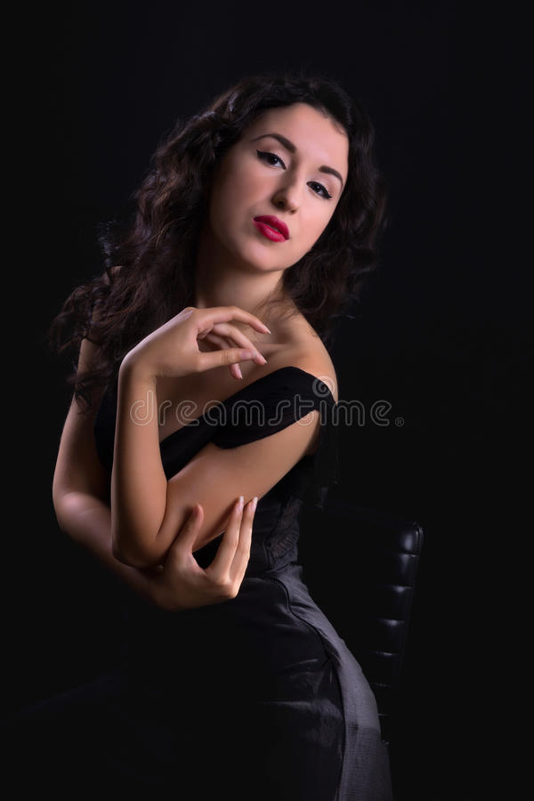 Hollywood diva portrait. Stunning black haired model posing in vintage style like a hollywood actress royalty free stock photos
