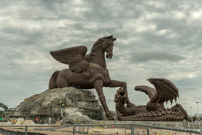 HOLLYWOOD, FLORIDA - APRIL 30, 2015: Sculpture in Miami. Pegasus and Dragon is a 100 foot tall statue of Pegasus defeating a drago stock images