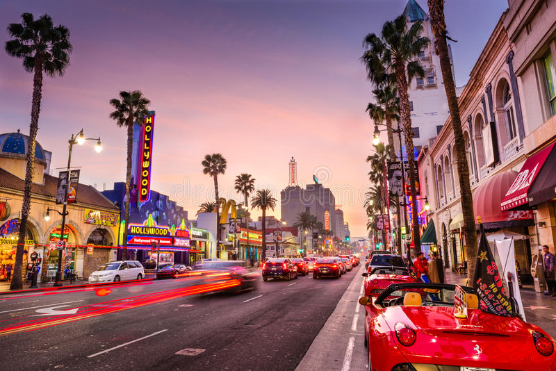 Hollywood, Los Angeles. LOS ANGELES, CALIFORNIA - MARCH 1, 2016: Traffic on Hollywood Boulevard at dusk. The theater district is famous tourist attraction royalty free stock image