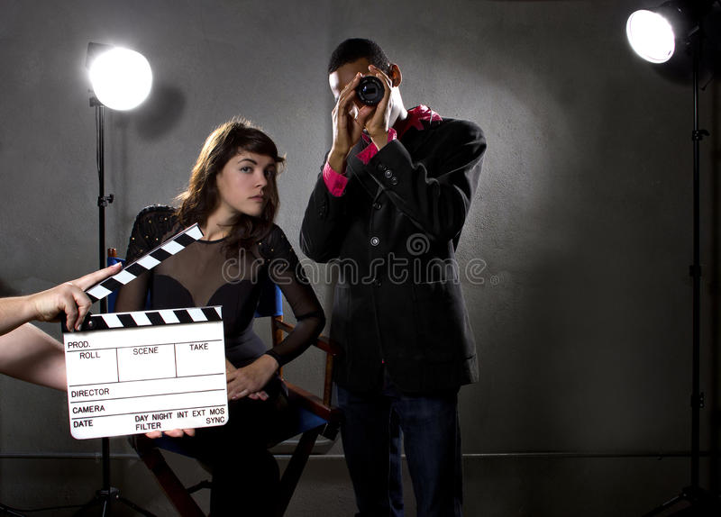 Hollywood Producers. Hollywood film industry producers or directors in a sound stage royalty free stock image