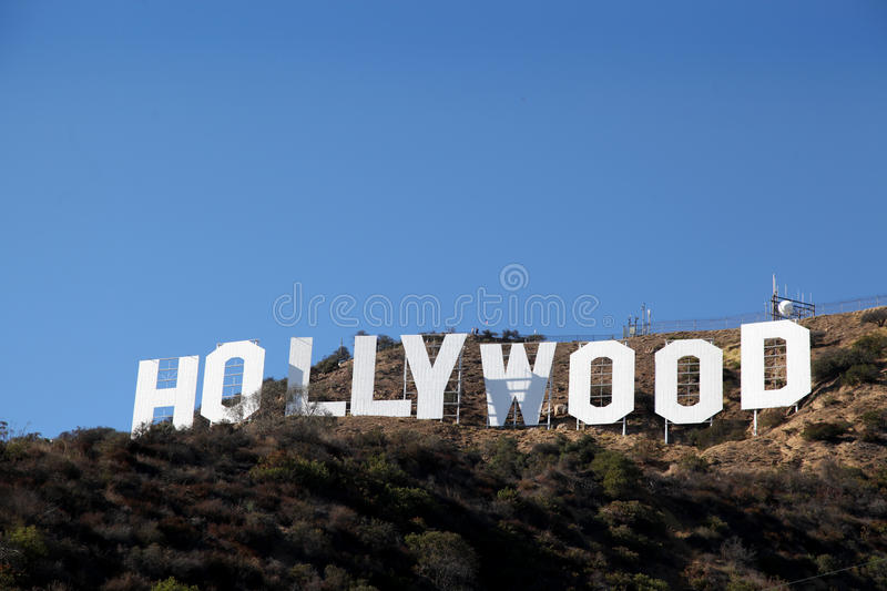 Hollywood Sign. The Hollywood Sign is a landmark and American cultural icon located in Los Angeles, California. It is situated on Mount Lee, in the Hollywood royalty free stock photography
