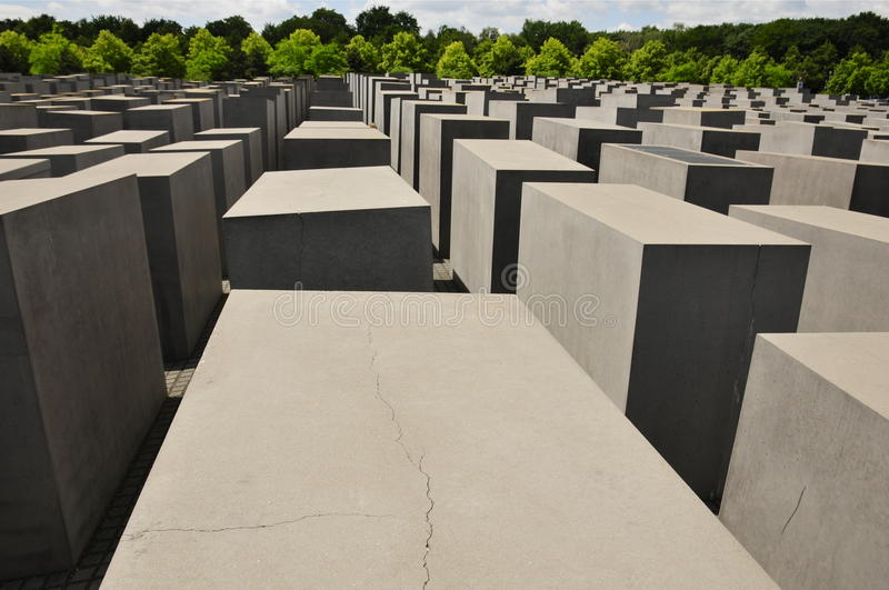 Holocaust Denkmal, Berlin. Concrete Stelae of the Holocaust Memorial for the murdered Jews in Europe in Berlin (Portrait Mode royalty free stock photo