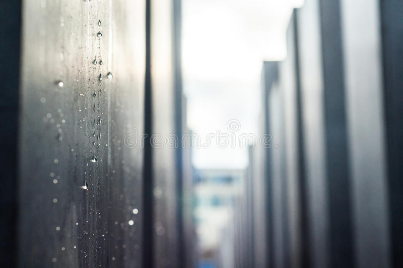 Holocaust memorial in berlin in grey rainy day with rain drops royalty free stock images