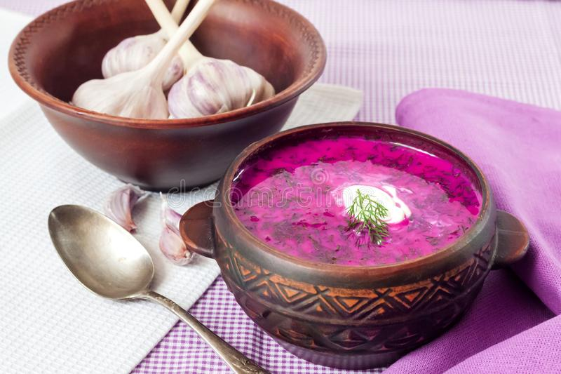 Holodnik - traditional Lithuanian Russian, Ukrainian, Belorussian, Polish cold beetroot soup. With cucumber, boiled eggs and greens in rustic bowl royalty free stock photo