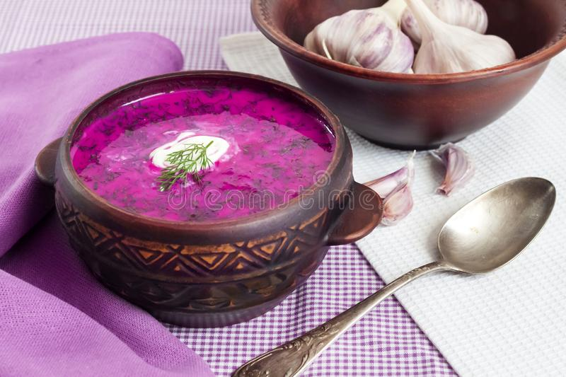 Holodnik - traditional Lithuanian Russian, Ukrainian, Belorussian, Polish cold beetroot soup. With cucumber, boiled eggs and greens in rustic bowl stock image