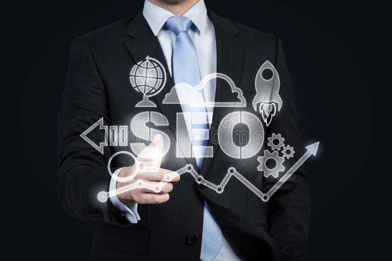 A hologram of business icons and a businessman offering handshake. A concept of business transaction stock photo