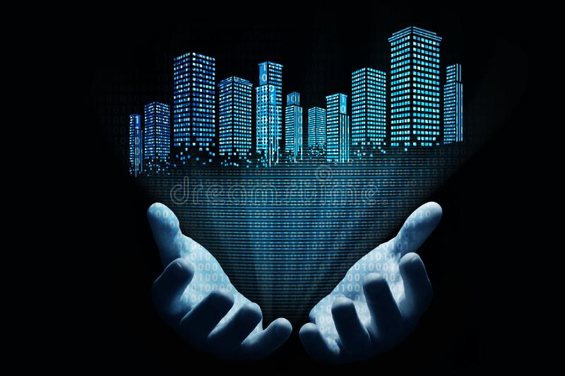 The hologram of a city with a binary code comes from the hands stock image