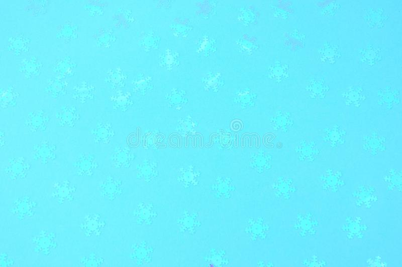 Holographic foil snowflakes confetti sparse on trendy blue colored background. Holographic foil snowflakes confetti sparse on trendy blue background. Simple stock image