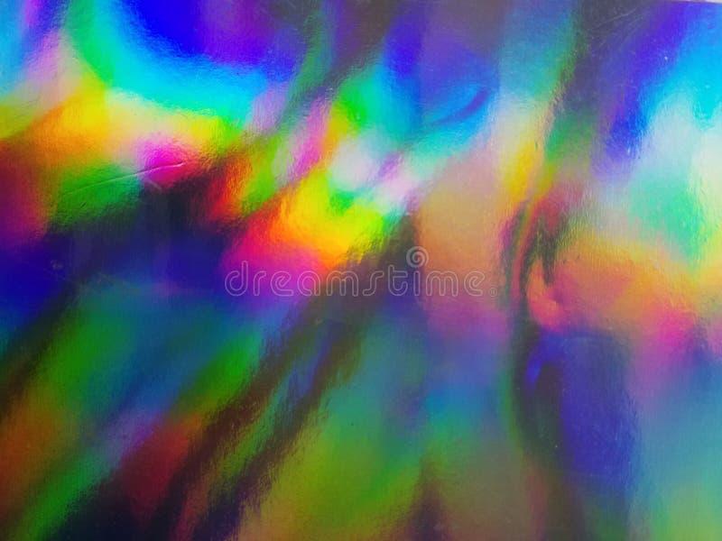 Holographic folietextur Regnbågemagibakgrund arkivbilder