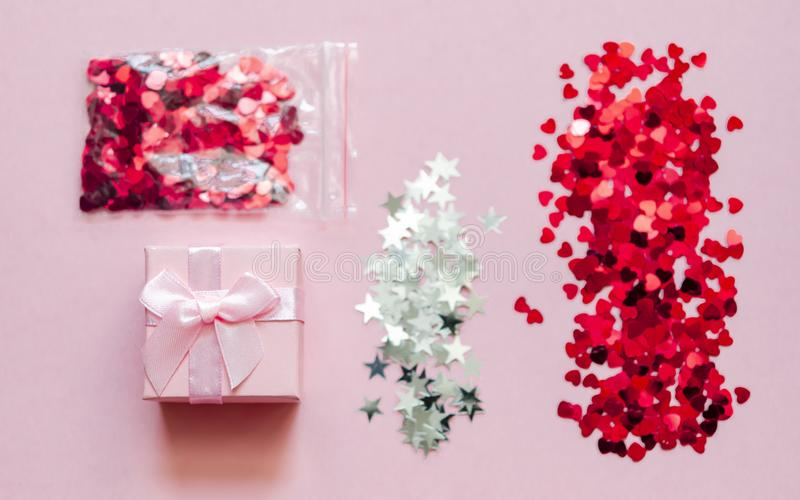 Holographic hearts and stars on trendy pink background. Festive backdrop. Top view stock image