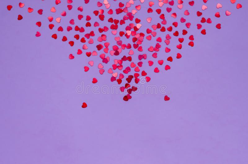 Holographic hearts on trendy purple background. Festive backdrop. Top view. Copy space royalty free stock photos