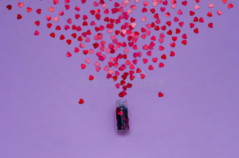 Holographic hearts on trendy purple background. Festive backdrop. Top view. stock image