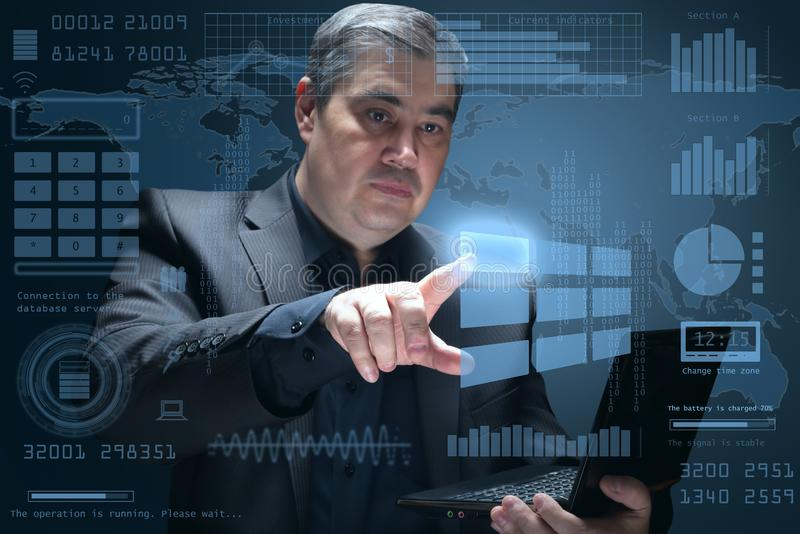 The businessman clicks on the virtual screen - futuristic interface stock images