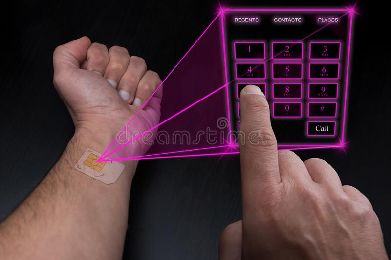 Holographic telephone keypad projected by the implanted SIM under the skin royalty free stock photography
