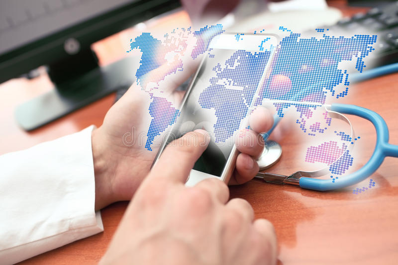 Holographic world map in the hands of the medical practitioner royalty free stock photos