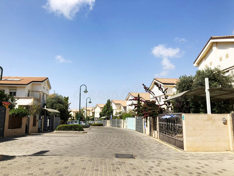 HOLON, ISRAEL  April 02, 2019: Private houses, trees and streets in Holon, Israel.  stock photo