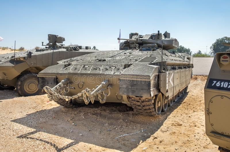 Namer is an Israeli armoured personnel carrier based on a Merkava Mark IV tank chassis presented on military show. HOLON, ISRAEL - SEPTEMBER 28, 2018: Namer is stock images