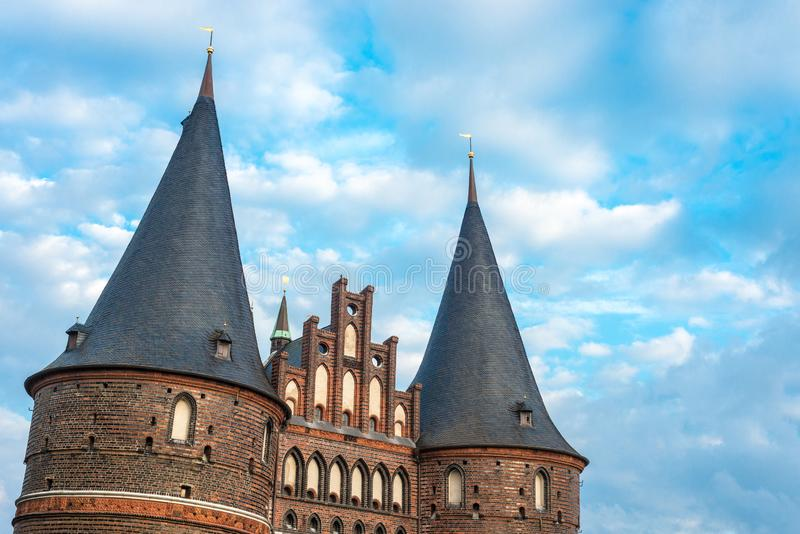 Holsten Gate in Luebeck, Germany. Holsten Gate Holstentor, a city gate marking off the western boundary of the old center of Luebeck in Schleswig-Holstein royalty free stock photos