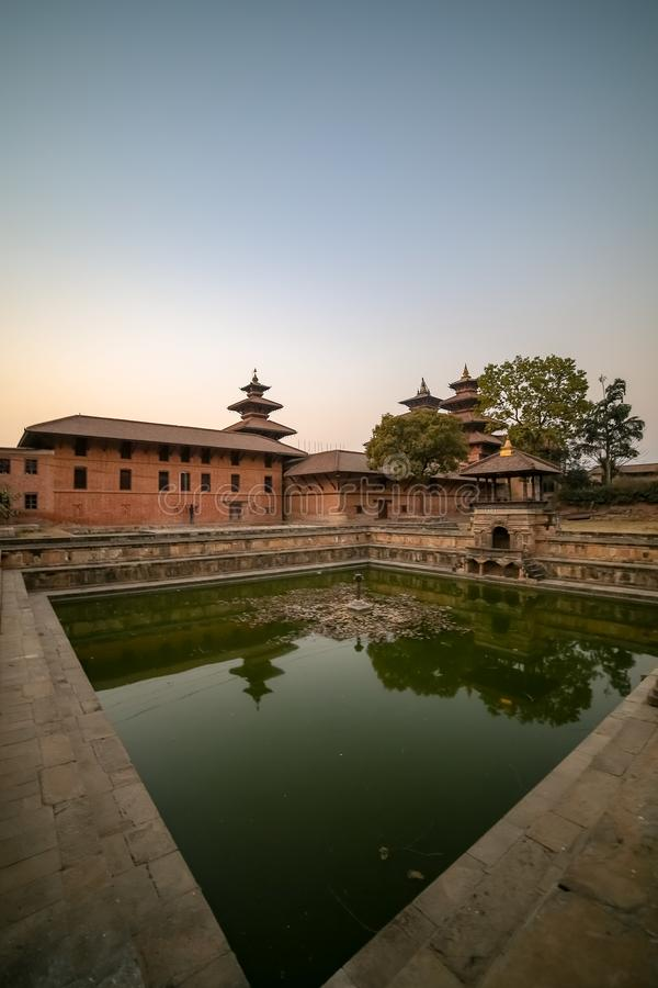 Patan Durbar Square. Holy and ancient pond at Patan Durbar Square stock photography