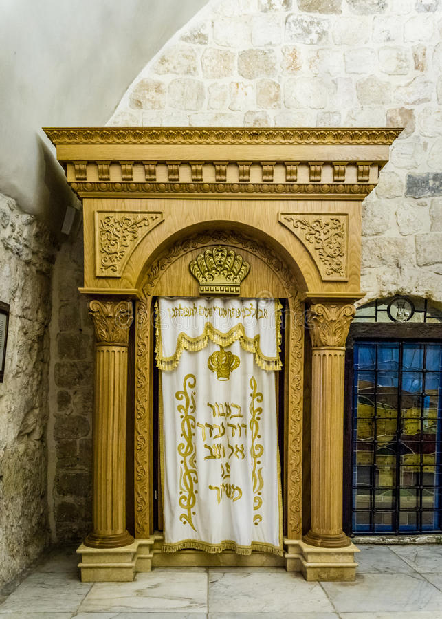 The Holy Ark for Torah old testament scrolls, Jerusalem. JERUSALEM, ISRAEL - OCTOBER 5: The Holy Ark with curtain covering containing the Holy Torah old stock image