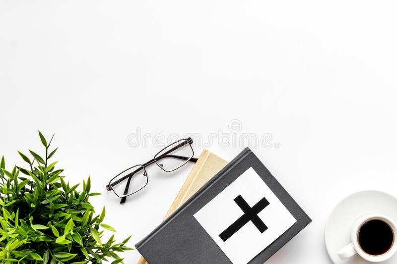 Holy Bible book with catholic cross - catholicism religion concept - on white background top view. Copy space. Holy Bible book with catholic cross - catholicism stock image