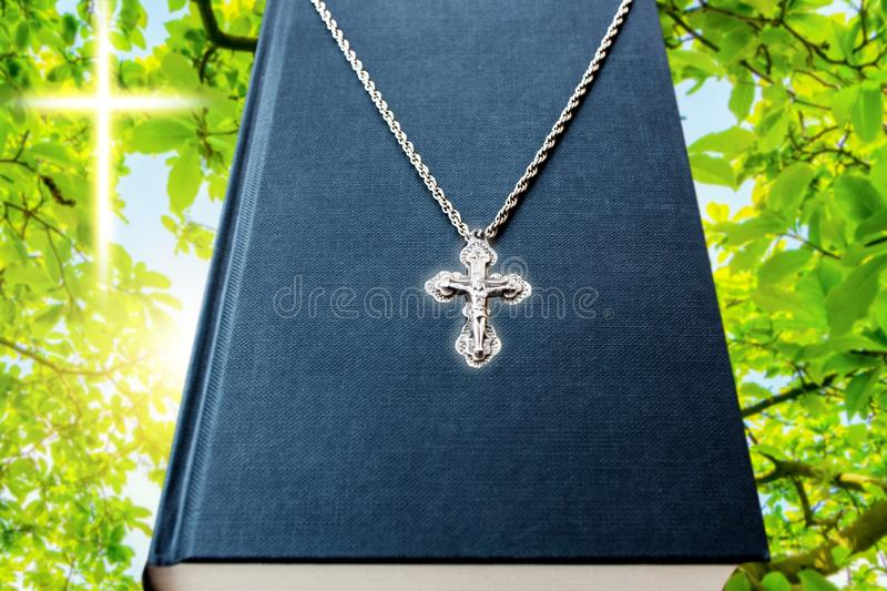 Holy Bible book . Wooden crucifix royalty free stock photo