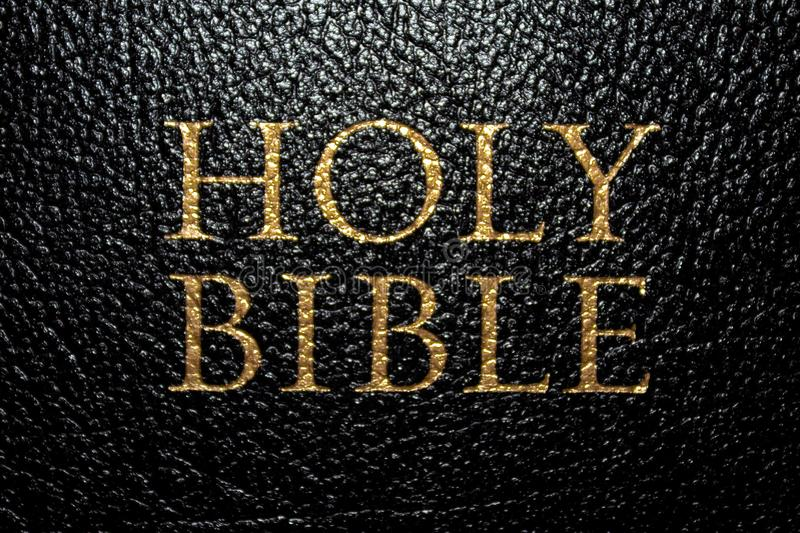 The Holy Bible. Close up of a black and gold Holy Bible royalty free stock photo