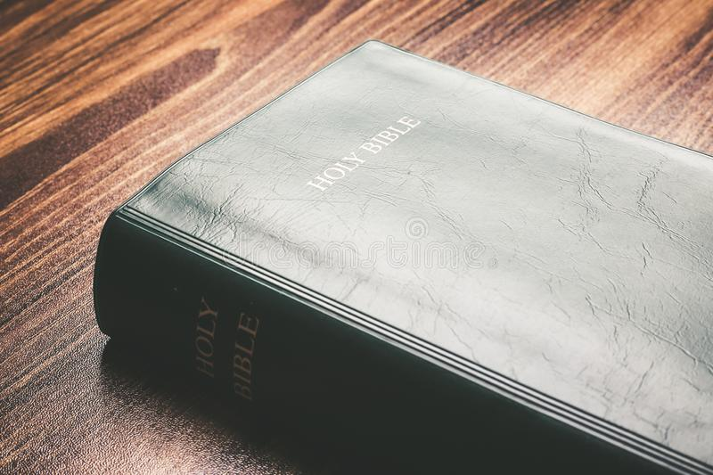 Holy Bible On The Desk. Holy bible on the wooden desk royalty free stock photos