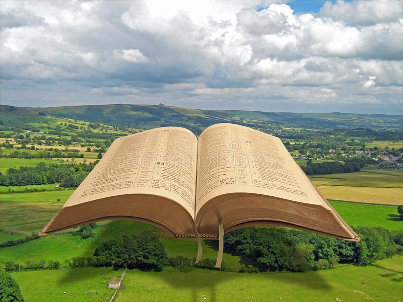Holy bible open book heaven scripture prayer pray psalms worship god land earth world globe planet green. Concept photo of open holy bible raised above god`s stock photography