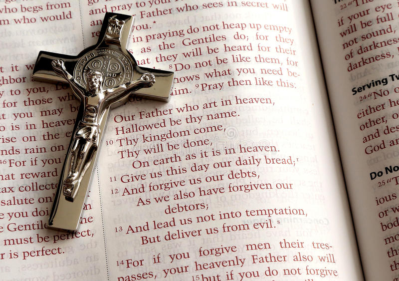 Holy Bible, prayer Our Father and Cross stock photo