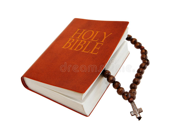 Holy Bible and a rosary. Isolated on white background stock photo