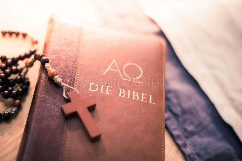Holy bible and rosary: Christian bible and rosary on a wooden desk. Holy bible and rosary are lying on a wooden desk religion bibel religious catholic church royalty free stock photos