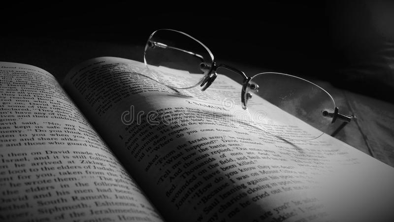 Holy Bible With Spectacle stock images
